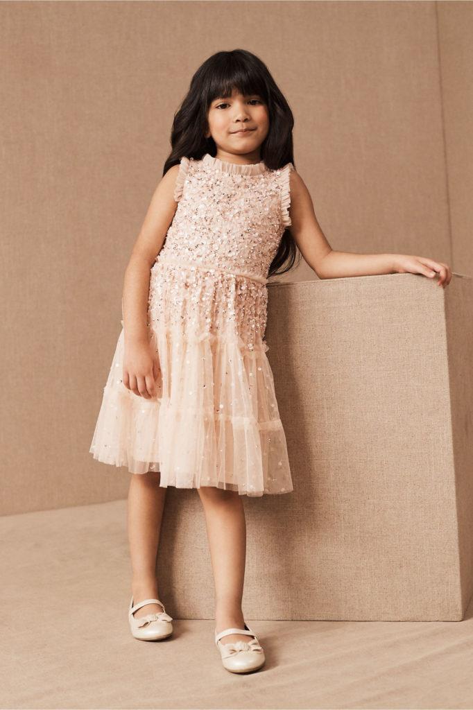Girl in beaded blush flower girl dress