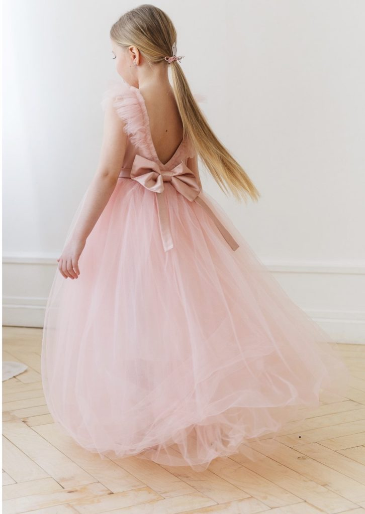 Girl in pink dress with bow