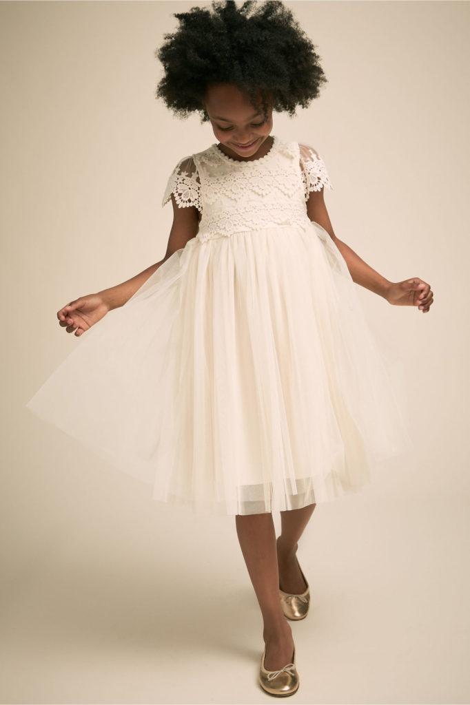 Girl in white flower girl dress