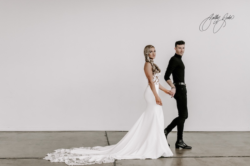 Long-train, white wedding dress model and designer