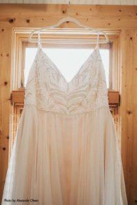 Simple blush wedding dress on hanger