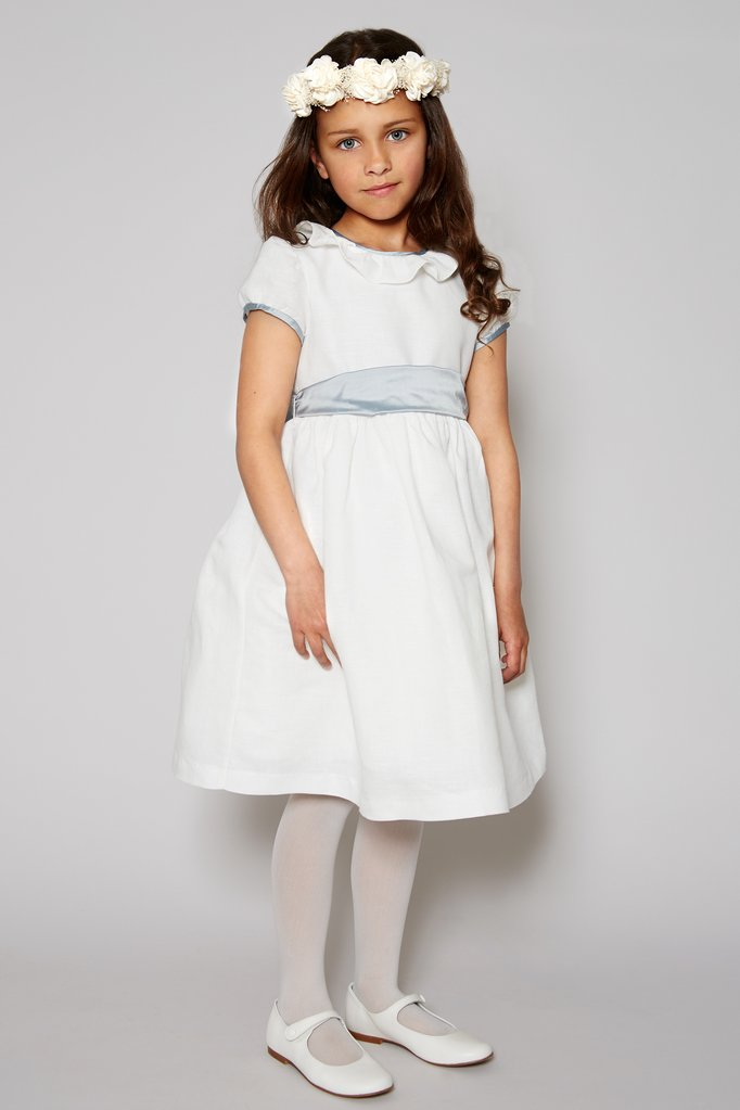 Flower girl in white dress with blue sash