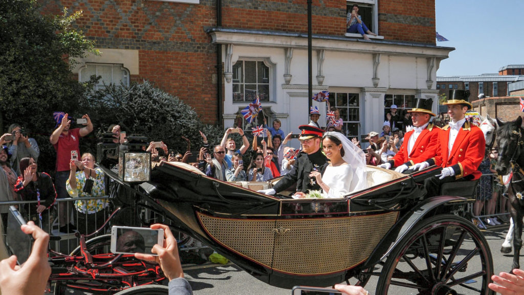 Prince Harry and Meghan Markle greet fans in carriage following wedding