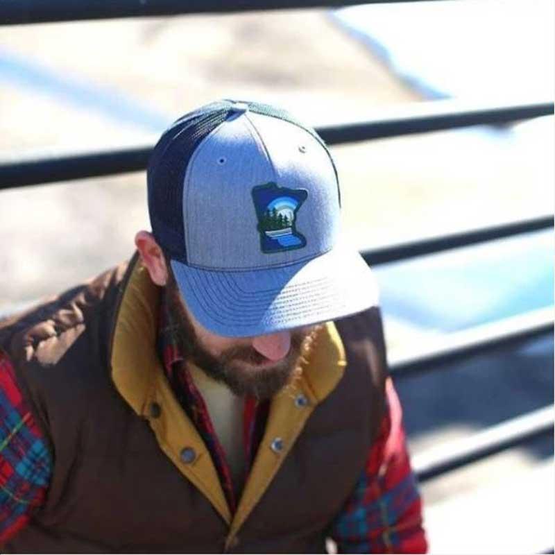 Man in Minnesota baseball cap
