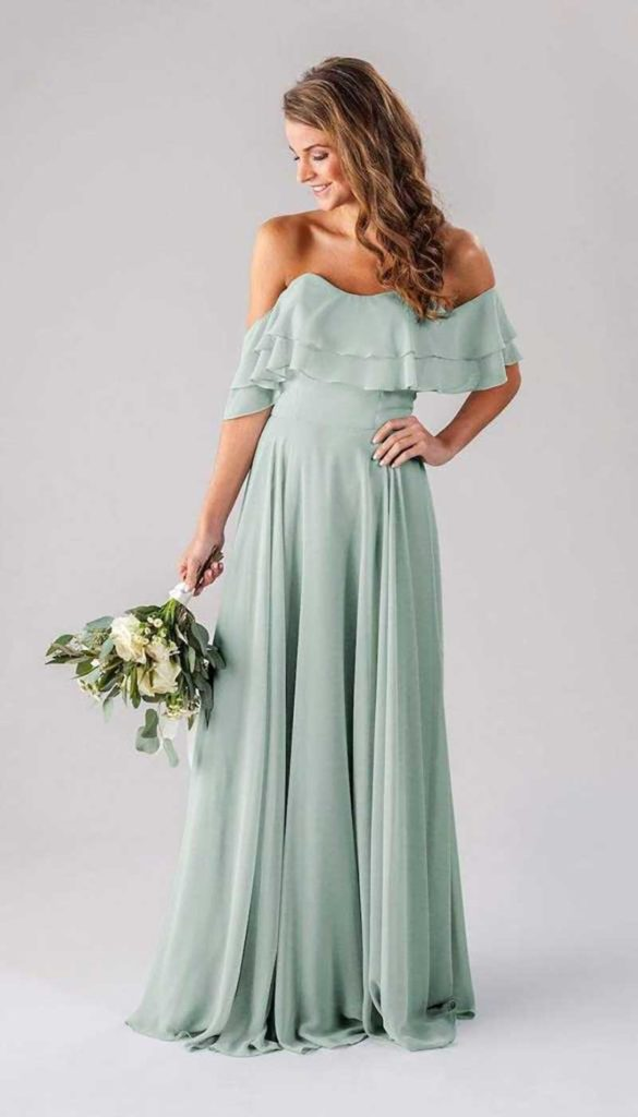 Woman in mint colored bridesmaid dress