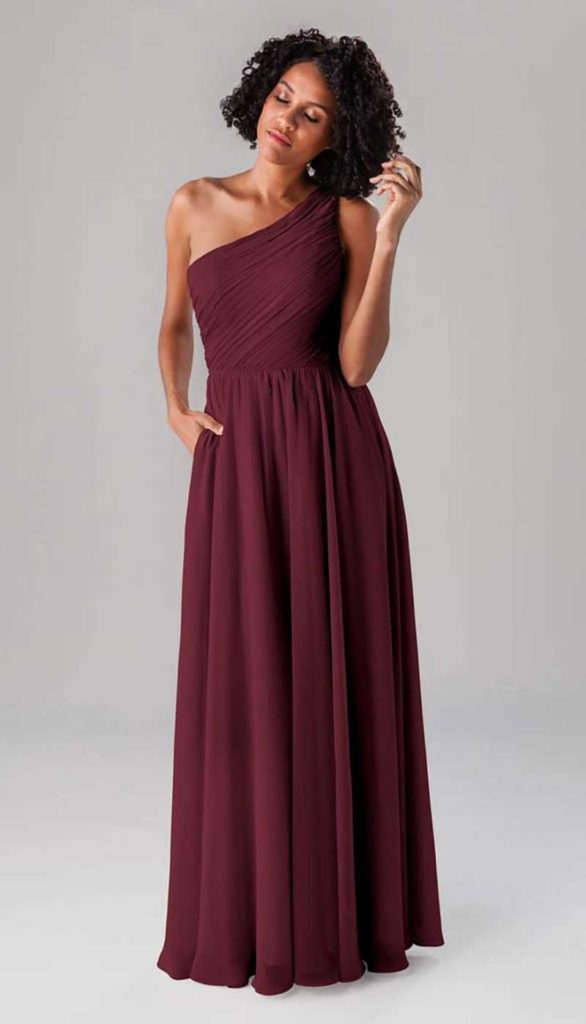 Woman in burgandy bridesmaid dress