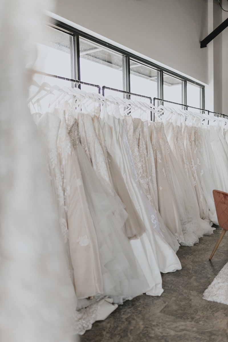 Wedding gowns on rack at bridal shop