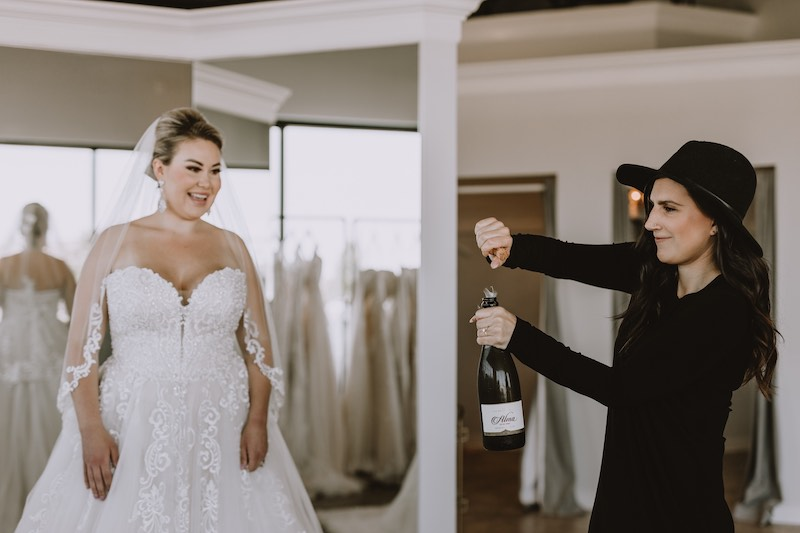 Bride in white dress with consultant in black top