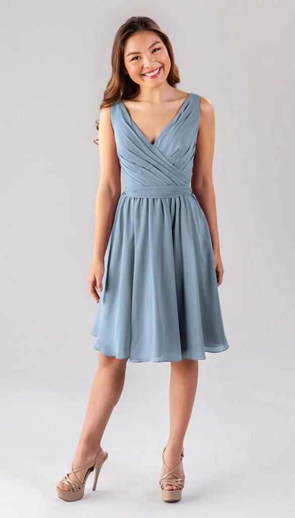 Woman in light blue bridesmaid dress