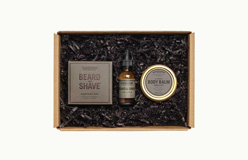 Box with beard oil, bodu balm, and soap