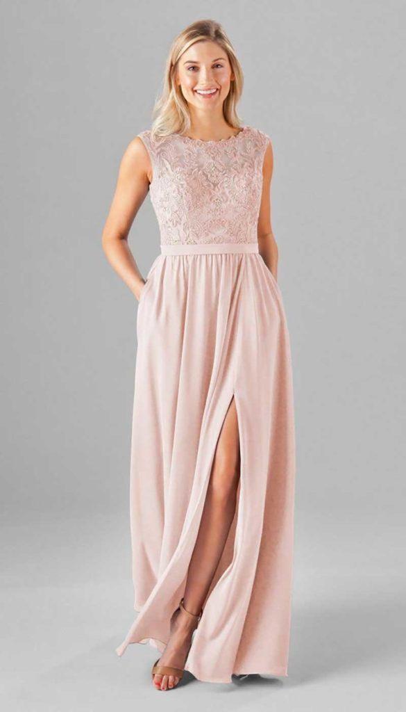 Woman in blush bridesmaid dress