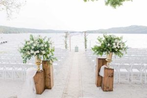 White and green wedding ceremony by lake