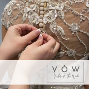 Seamstress altering bridal gown