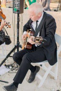 Man plays guitar during wedding ceremony