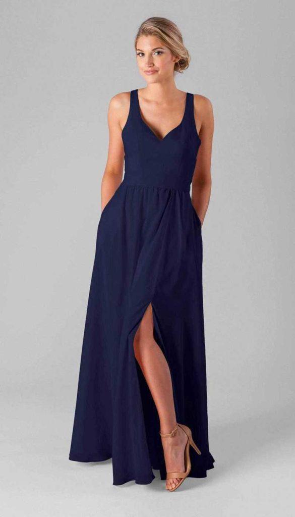 Woman in dark blue bridesmaid dress