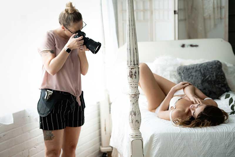 Boudoir photographer takes image of bride