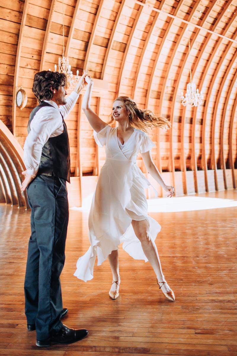 Couple practices wedding dances at Tulle Tuxedo Wedding Dance company